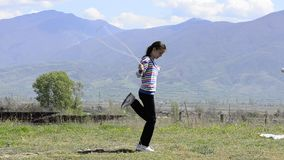 Girl skipping rope on a meadow stock video footage
