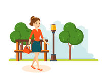 Girl in skirt and blouse, walks in the park resting. Royalty Free Stock Image