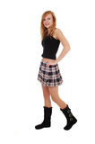 Girl in skirt and boots. Stock Photography