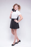 Girl in skirt and jacket smiles Royalty Free Stock Photos
