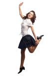 Girl in skirt jumping one leg  isolated white. Looking in camera. More images of this models you can find in my portfolio Royalty Free Stock Photo