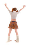Girl in skirt standing back to camera Stock Photography