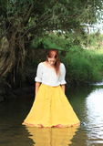 Girl in skirt in water Stock Photos