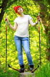 Girl on skis. Young beautiful girl in the summer on skis royalty free stock photography