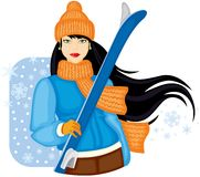 Girl with skis. Girl in orange warm hat and scarf holding skis Stock Photography