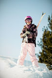 Girl with skis Stock Images