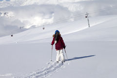 Girl on skis in off-piste slope with new fallen snow at nice day Royalty Free Stock Image