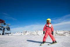 Girl on skis in soft snow Stock Photos