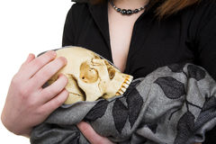Girl with skull Stock Images