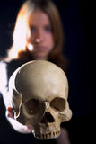 Girl with skull Royalty Free Stock Image