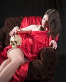 Girl with skull Stock Image