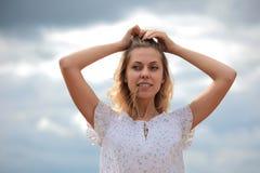 Girl and sky Stock Image