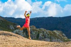 Girl skyrunner trains downhill Stock Photo