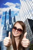 The girl and skyscrapers Royalty Free Stock Image