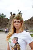Girl of Slavic appearance in a military garrison cap Stock Photo