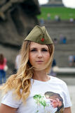 Girl of Slavic appearance in a military garrison cap Royalty Free Stock Photography