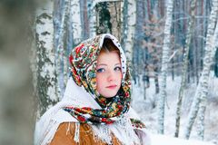 Girl - Slavic appearance wrapped in a scarf in winter royalty free stock photography