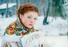 Girl - Slavic appearance wrapped in a scarf in winter royalty free stock images