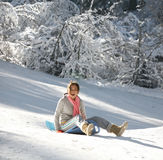 Girl on a sled. Teenage girl enjoying her sled ride royalty free stock photo