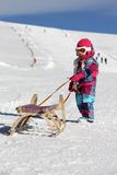 Girl with sled Stock Image