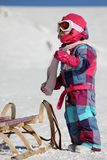 Girl with sled Royalty Free Stock Photos