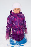 Girl on a Sled. Cute little girl on a sled stock photography