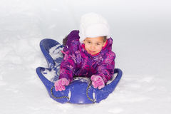 Girl on a Sled royalty free stock image