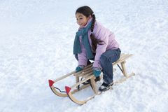 Girl on a sled having fun Stock Photography