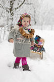 Girl and sled Royalty Free Stock Image