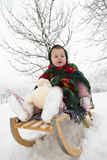 Girl on a sled Stock Photography