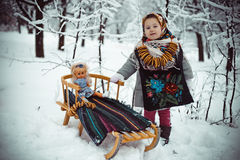 Girl on a sled Stock Photo