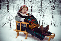 Girl on a sled Royalty Free Stock Photography