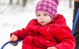Girl with sled in a park Stock Photo