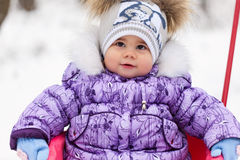 Girl with sled in a park Stock Photography