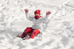 Girl  sled through the snow Royalty Free Stock Photos