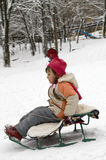 Girl sledding. Stock Photo
