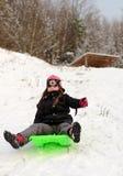 Girl sledding Stock Photo