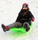 Girl sledding Royalty Free Stock Photo
