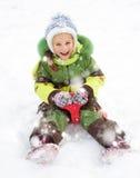 Girl sledding Stock Photos