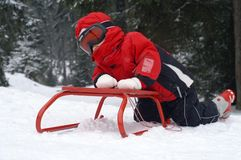 Girl with sledge Royalty Free Stock Photo