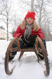 Girl with sledge. Winter, outdoor royalty free stock photo