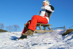 Girl on sledge stock images