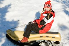 Girl on the sledge Royalty Free Stock Photography