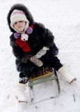 Girl on sledge Royalty Free Stock Photography