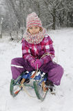 Girl with sledge Royalty Free Stock Photos