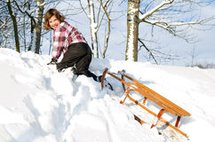 Girl with sledge in the snow Royalty Free Stock Photo