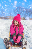 Girl on sledges Stock Photos