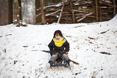 Girl sledging Stock Images
