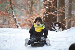 Girl sledging Stock Image
