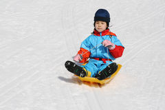 Girl sleding from hill. Girl sleding from snow hill Royalty Free Stock Images